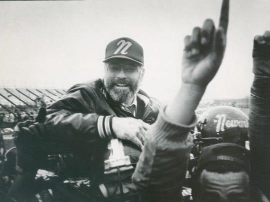 Butch Simpson celebrates with his Newark High players in 1985.