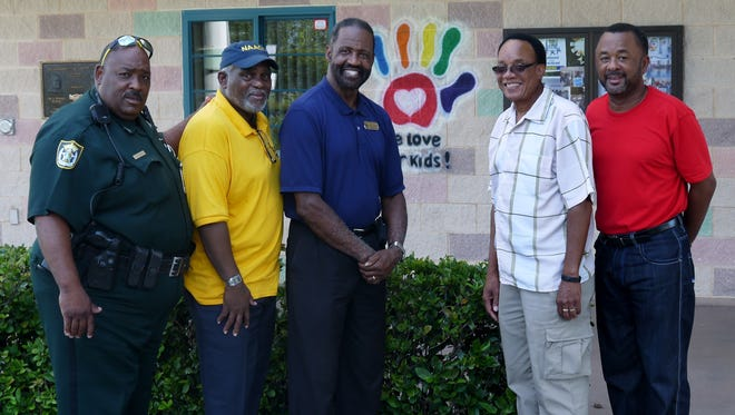 """The five """"pillars"""" of the Gifford community (from left) Indian River County Sheriff's Deputy Teddy Floyd, Tony Brown of the NAACP, Freddie Woolfork of the GYAC, the Rev Benny Rhyant of the Pastors Association, and Joe Idlette from the Civic Legion of Gifford."""