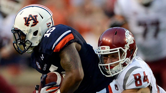 Auburn defensive back Joshua Holsey was back at safety on Monday after practicing at cornerback the first three practices of fall camp.