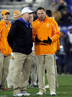 Nov 30, 2013; Lexington, KY, USA; Tennessee Volunteers head coach Butch Jones and Kentucky Wildcats head coach Mark Stoops talk before the game at Commonwealth Stadium.