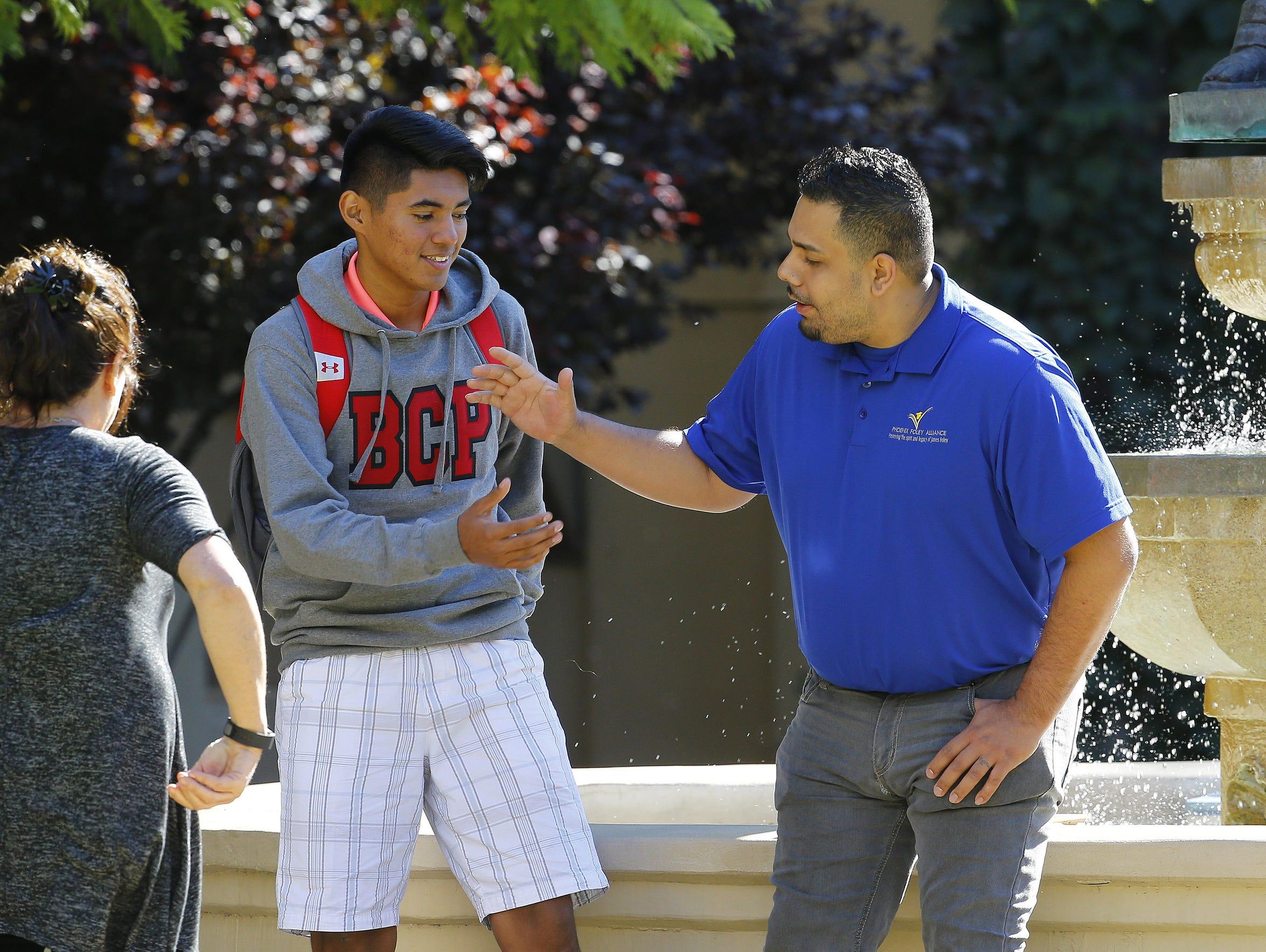 Eddie Martinez visits with Juan Alvarado on Nov. 22,