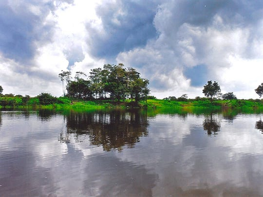 Brazil is known for its natural wonders, such as this maze of waterways, large tracts of open and forested land and vast skies making up the immensity of the Amazon in Brazil, about 100 miles from the city of Manaus.