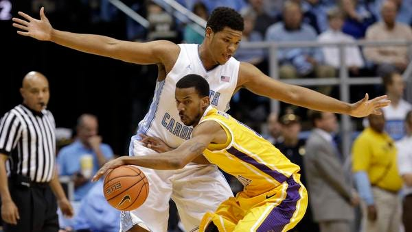 North Carolina's Kennedy Meeks, top, guards East Carolina's Antonio Robinson during the first half in Chapel Hill on Sunday.