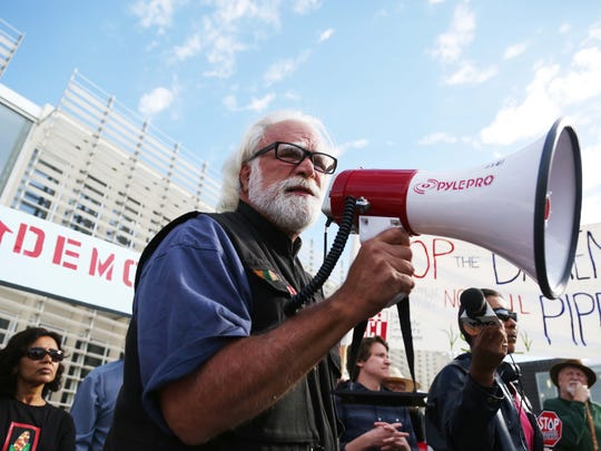 Frank Cordaro, of Des Moines speaks to the crowd during the Stop the Bakken Pipeline Rally and Speak Out on Thursday, Oct. 15, 2015, outside the Iowa Utilities Board Office in Des Moines.