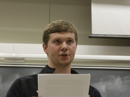 Kevin Lasher, president of Purdue Students for Life, read from a statement Monday, Feb. 8, 2016, during the group's meeting. Protesters organized a sit-in to show disapproval for the group's recent anti-abortion campaign that targeted black women.