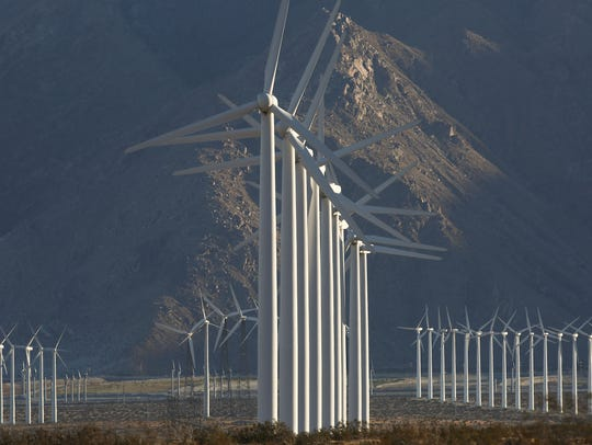 Wind turbines generate electricity near Whitewater, Calif., just outside Palm Springs, on Oct. 6, 2016.