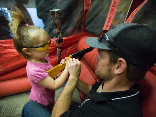 Matilda Gifford,4, gets a few B.B. gun shooting saftey tips from Curtis Davidson, with the Mesilla Valley Longbeards a chapter of the National Wild Turkey Federation, in the BB gun range during the Mesilla Valley Outdoor Expo at the Las Cruces Convention Center, January 14, 2017.
