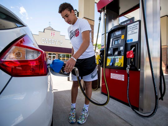 Jack Vermeer, 15, puts E15 fuel in his 2014 Ford Focus at a Casey's General Store in Pella on May 30, 2017. E15 is banned in the summer, based on concerns it contributes to smog, a claim ethanol advocates say is unfounded.