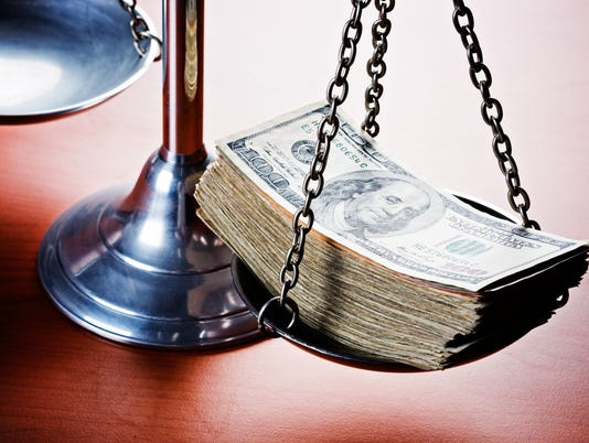 Scales of Justice weighed down by multi-dollar bribe. Corruption!