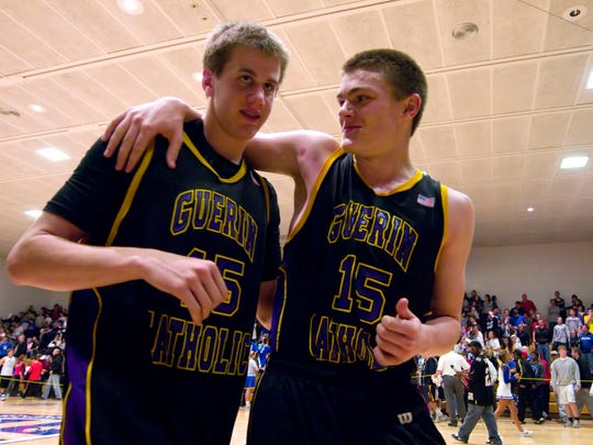 Guerin Catholic's Aaron Brennan, left, and teammate, Adam Hufford, celebrate their victory over Bishop Chatard Jan. 6, 2012.