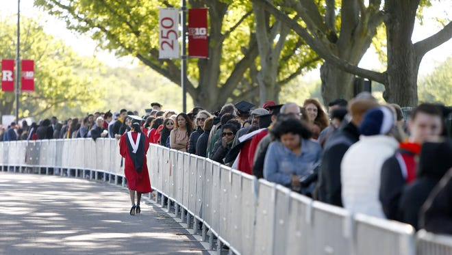 People wait to be screened to enter High Point Solutions Stadium in Piscataway, NJ, Sunday, May 15, 2016, where President Barack Obama will be delivering the commencement address there later in the day.