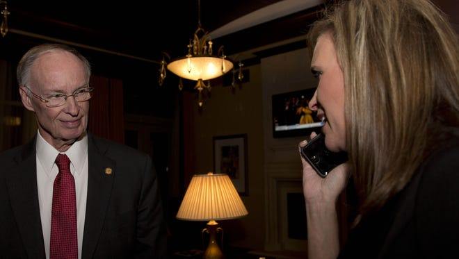 -In this Tuesday, Nov. 4, 2014 file photo, Republican Gov. Robert Bentley listens to a  phone call as Rebekah Mason, right, announces his win for Alabama governor, in Montgomery, Ala. Bentley defeated his opponent Democrat Parker Griffith. Bentley admitted Wednesday, March 23, 2016,  that he made inappropriate remarks to his senior political adviser, Rebekah Caldwell Mason. Bentley said he did not have a sexual relationship with Mason, but he apologized to his family and Mason's for his behavior.