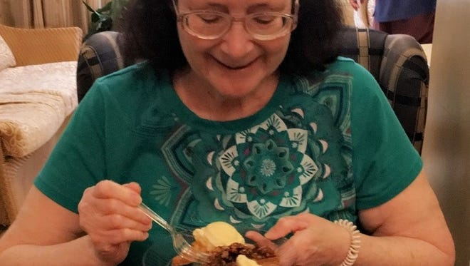 Spring Hills Morristown Assisted Living resident Hazel Rorke can't take her eyes off her pecan pie to smile at the camera during a celebration of National Pecan Pie Day.