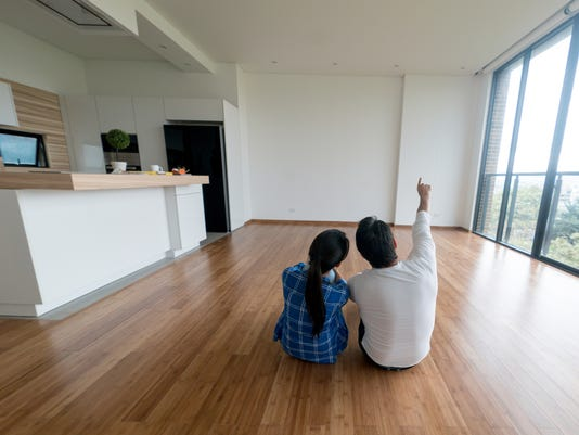 Couple at their new home