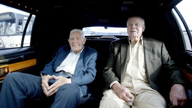 Jud Heathcote, right, and Marv Harshman were chauffeured to a Kitsap County Bremerton Athletic Roundtable meeting in this 2005 photo. Heathcote, a 1945 South Kitsap grad, died this week in Spokane at age 90.