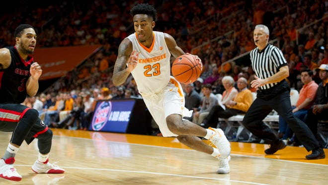 Tennessee's Jordan Bowden (23) dribbles during an NCAA SEC basketball game between the Tennessee Volunteers and the Georgia Bulldogs at Thompson-Boling Arena in Knoxville, Tennessee on Saturday, February 11, 2017.