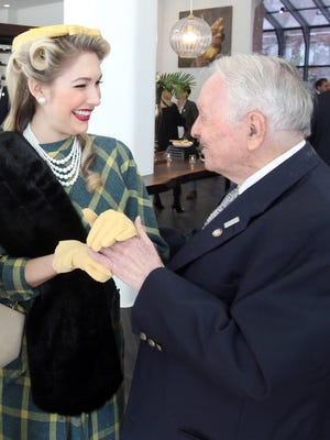 Covington businessman and philanthropist Oakley Farris (right) chats with Karissa Yates, a model dressed in 1950's style clothes during the grand opening of the Hotel Covington.