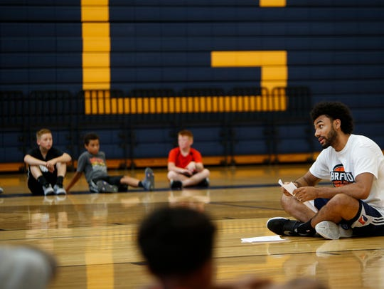 Jon Horford talks to kids Friday at the beginning of