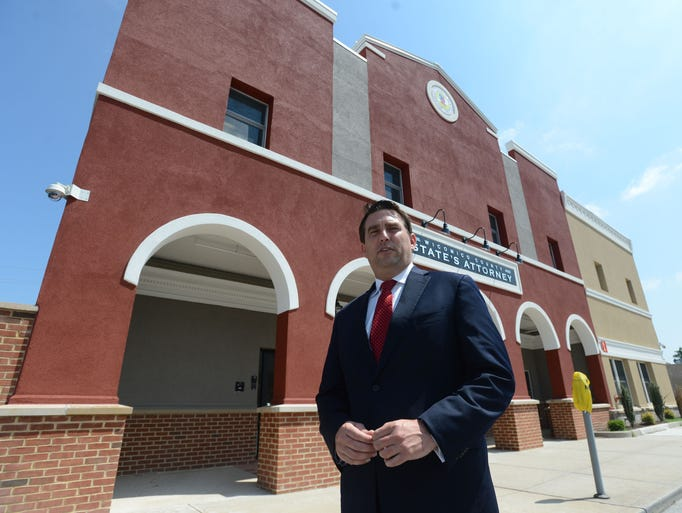 Wicomico County States Attorney Matt Maciarello at the entrance way outside for their new office on Main Street in Salisbury.