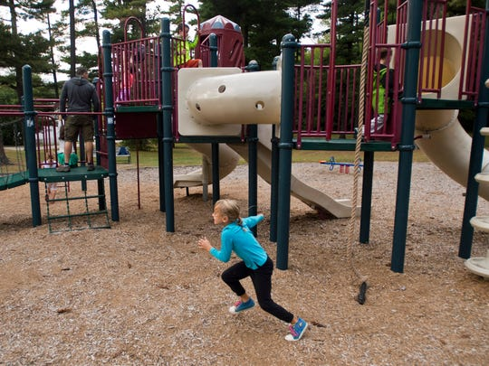 Kids play at Ethan Allen Park in Burlington's New North End Monday afternoon, September 28, 2015. Residents recently discover glass all over the play structure, on the slide, even inside the tunnels.
