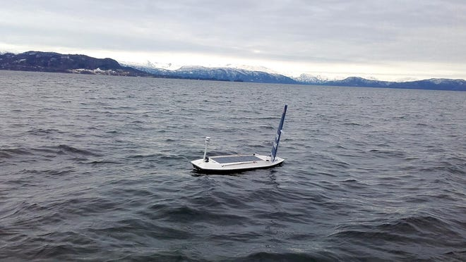 In this photo taken on March 14, 2018 and provided by Offshore Sensing, an autonomous Sailbuoy operated by Norwegian company Offshore Sensing performs a demonstration in the waters of Bjornafjorden, near Bergen, Norway. A Sailbuoy completed the Microtransat Challenge in late August, becoming the first to complete the trans-Atlantic challenge for autonomous vessels since the contest began in 2010.