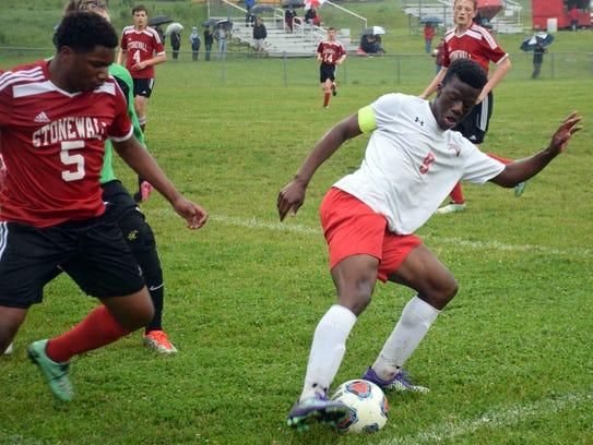Riverheads' Josh Akinwumi, right, keeps the ball away
