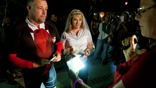 Michael Flynn and Darlene Barnhart are married Friday at Centennial Park in downtown Fort Myers.
