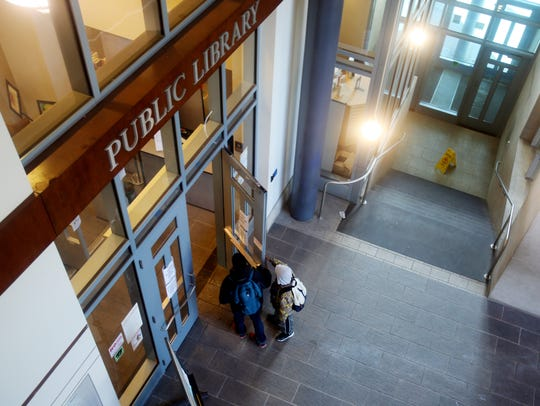 Two boys enter the Yonkers Public Library's Riverfront