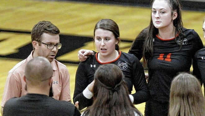 Delaware Hayes volleyball players Anna Johnson (center) and Bailey Christiansen (right) listen as coach Raynard Martin talks to the team during a match last season. Johnson, a senior setter, and Christiansen, a junior middle hitter, are expected to be among the key contributors for the Pacers.