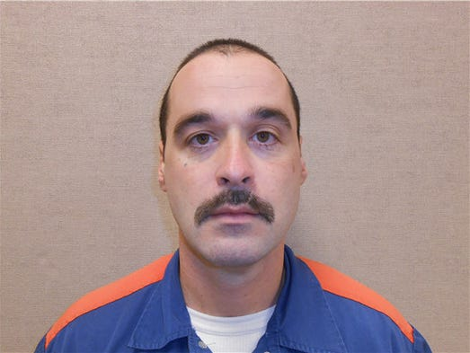 Michael David Elliot (shown in 2013), who is serving life behind bars for four 1993 murders in Michigan, has escaped from prison and may have abducted a woman before she got away in Indiana, officials said. Michigan Department of Corrections spokesman Russ Marlan said in an email that Elliot, 40, was discovered missing about 9:30 p.m. Feb. 2, 2014, from the Ionia Correctional Facility in mid-Michigan.