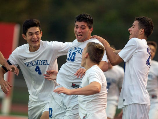 Anthony Arena celebrates with his team mates after