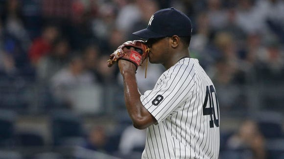 New York Yankees pitcher Luis Severino reacts after giving up a two-run home run to Chicago White Sox's Jimmy Rollins during the third inning of a baseball game Friday, May 13, 2016, in, New York.