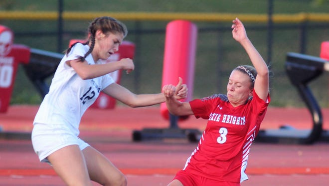 Notre Dame junior Maya Decker, left, and Dixie Heights senior Madison Webster battle for the ball during the Ninth Region girls soccer semifinals Oct. 18, 2017 at Dixie Heights High School. Notre Dame beat Dixie Heights 2-0 and St. Henry beat Highlands 2-0 in penalty kicks after a 0-0 tie.