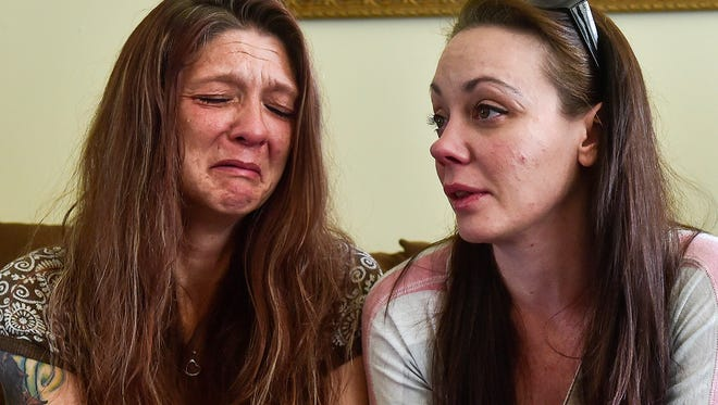 Bobbi Blanton, left, becomes emotional while discussing her daughter, Bailey Witzel, who was reported dead after a heroin overdose on Thursday morning. Jessica Davis, a friend, provided comfort to Blanton.