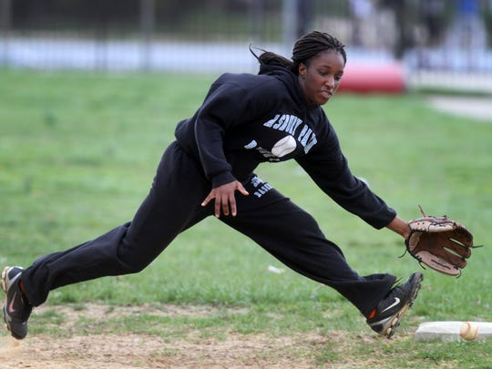 Asbury Park Middle School baseball player Nalah Tinsley fields a grounder while playing first base during a recent practice.