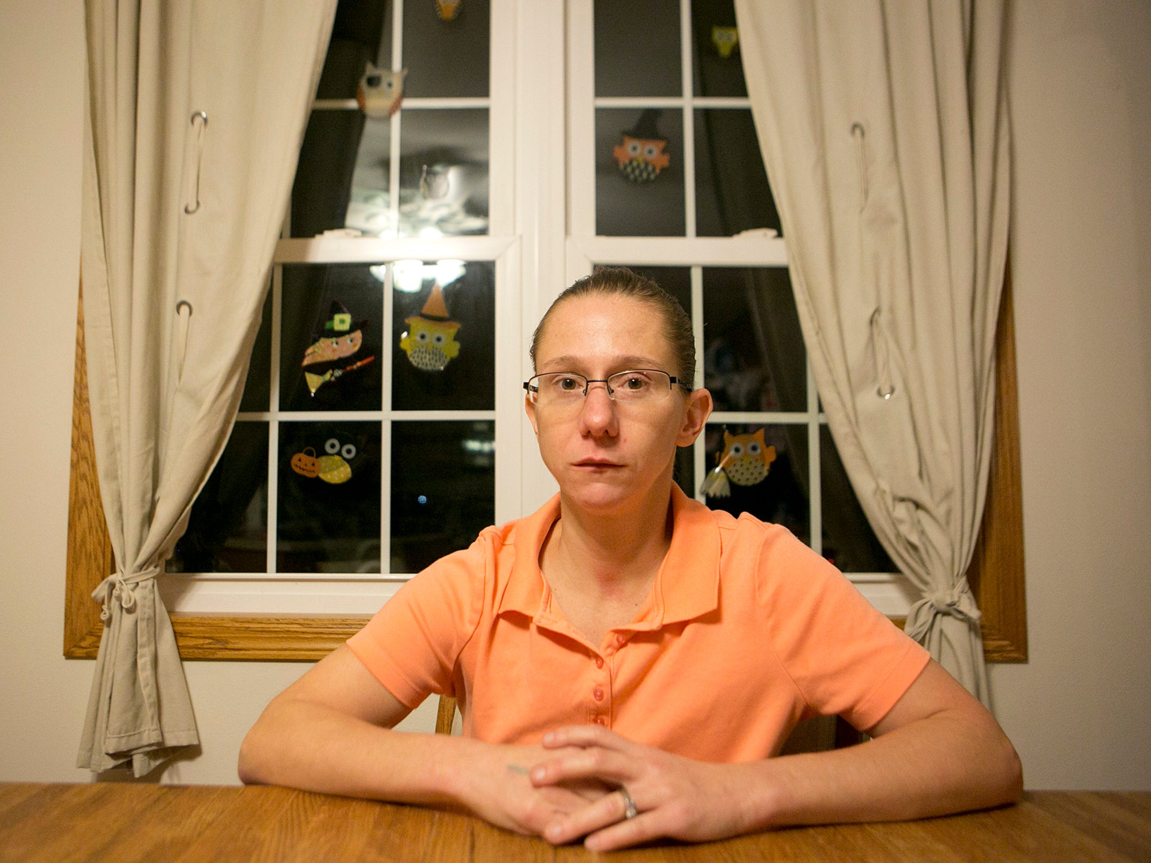 Jessyca Christianson sits in her home in Plover, Friday,