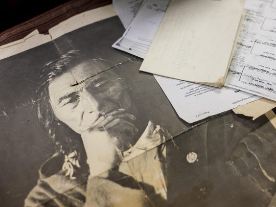 A photograph of Oske-na-wince or Young Man-Turtle Mountains next to historic documents. Bill Sitting Chief, the hereditary chief of Little Shell, and Nicholas Vrooman, Native American Rights Fund historian, hope it will help the tribe obtain federal recognition.