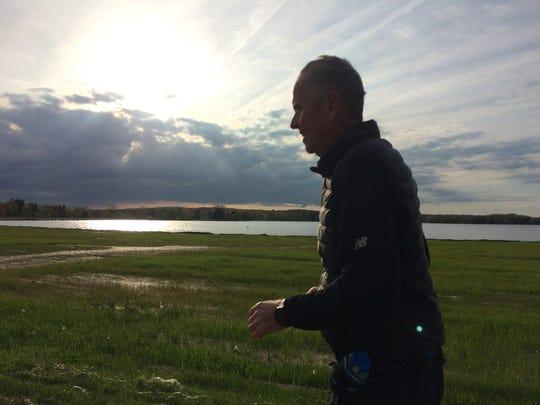 Bud Olafsson running six-mile laps around Stoney Creek