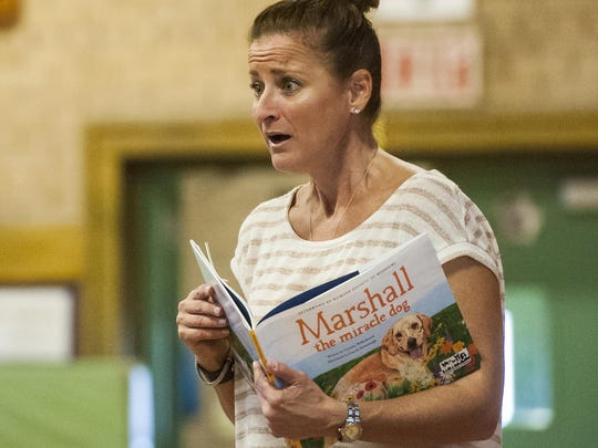 Cyndi Willenbrock teaches Roosevelt Elementary students about compassion and kindness through the story of Marshall the Miracle Dog.
