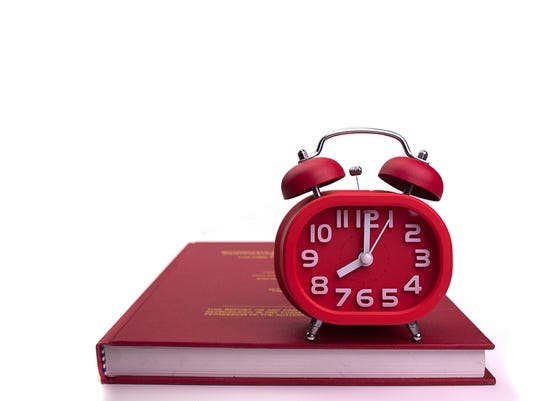 Alarm clock and books