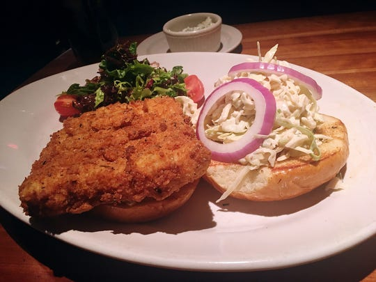 Fried white fish sandwich with green salad at Houston's