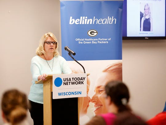 Kris Cahak talks to a crowd about the death of her daughter at a suicide awareness USA TODAY NETWORK-Wisconsin town hall meeting Tuesday at the Fond du Lac Public Library.