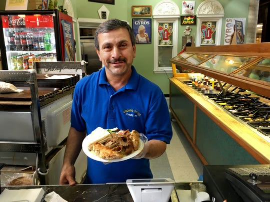 Ari Mamami shows off the gyro combo plate at Chicago