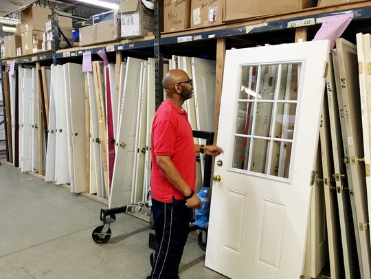 Joe Pendleton checks out a door at the Habitat ReStore.