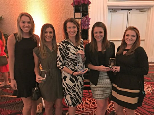 WithumSmith+Brown's marketing department has been awarded three of the Association of Accounting Marketing's coveted Marketing Achievement Awards AICPA ENGAGE conference gala recently held in Las Vegas. Withum Chief Marketing Officer Rhonda Maraziti (center) is pictured with (from left) marketing coordinators Brooke Morgan, Jessica Forenza, Ashley Krompier and Shannon Vercammen accepting one of the awards.