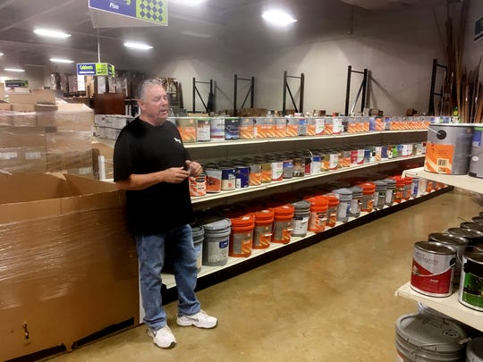 Habitat ReStore director shows off the paint section in the new  Habitat  ReStore that is opening August 1, in renovated K-Mart at the corner of Nolensville Road and Harding Place.