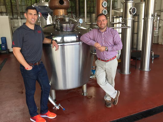 Central Standard Craft Distillery owners Pat McQuillan and Evan Hughes show off the new, larger still at their new facility in 2017.