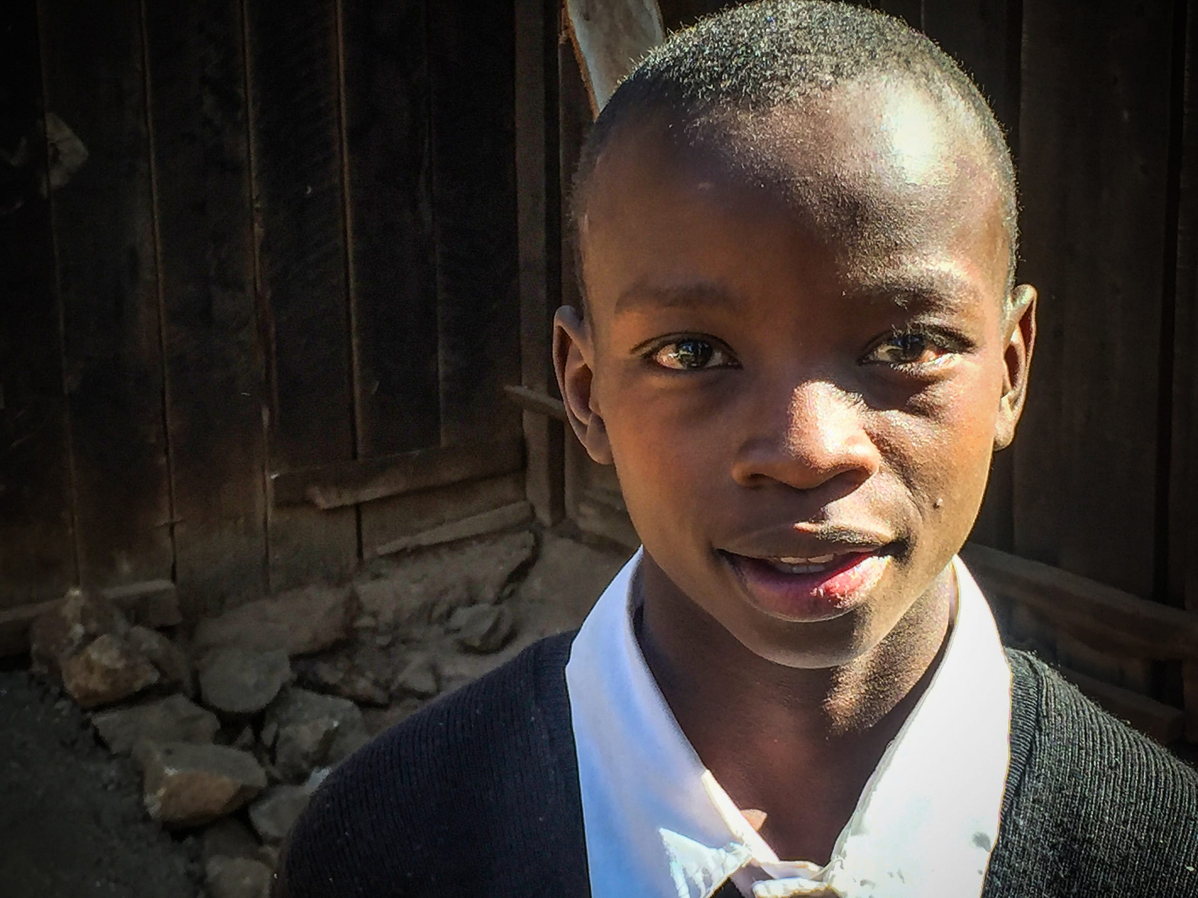 A Kenyan boy lives with his brother at a shelter for at-risk children near Nyahururu.