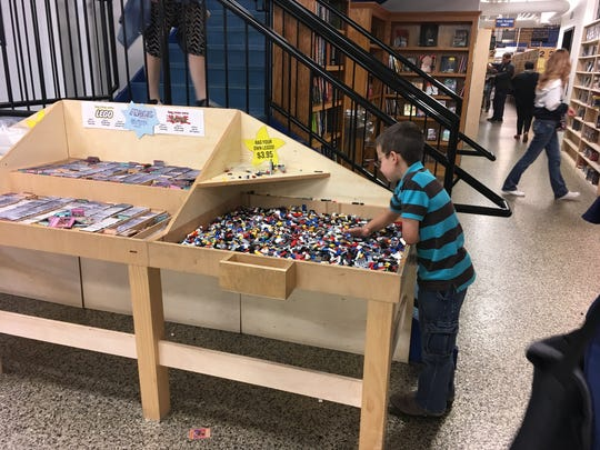 A young customer checks out the Legos for sale at  McKay's Books, Music, Movies and Games.