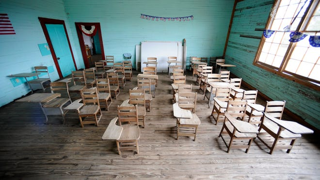 "This Wednesday, Jan. 27, 2016, photo shows a classroom in the old Mount Sinai Junior High School, a so-called ""Rosenwald School"" built for rural blacks during the Jim Crow era near Prattville, Ala."